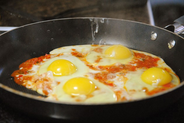 Cooking the eggs in salsa